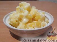 Фото к рецепту: Картофель тушеный в молоке