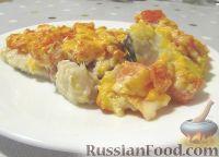 Фото к рецепту: Запеченная рыба под томатно-сырной корочкой