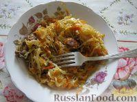 Фото к рецепту: Свинина тушеная с кислой капустой