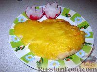 Фото к рецепту: Куриная отбивная, запеченная с сыром