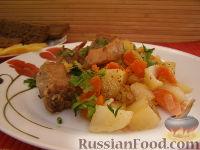 Фото к рецепту: Тушеные свиные ребрышки с картошкой