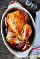 Фото к рецепту: Запеченная курица с яблоками и сливами