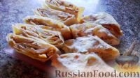 Фото к рецепту: Рулет из лаваша с грибами и плавленым сыром