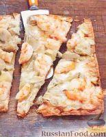 Фото к рецепту: Пицца из лаваша с креветками и артишоками