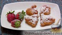 Фото к рецепту: Пирожки с творогом, из слоёного теста, жаренные во фритюре
