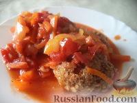 Фото к рецепту: Тефтели с рисом и овощным соусом