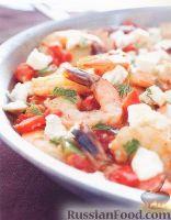 Фото к рецепту: Креветки с помидорами и фетой