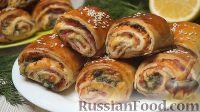 Фото к рецепту: Слойки-рулетики с ветчиной и сыром