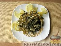 Фото к рецепту: Салат из морской капусты, кальмаров и яиц (без майонеза)