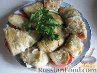 Фото к рецепту: Рулетики из баклажанов с помидорами