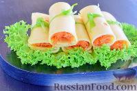 Фото к рецепту: Сырные рулетики с морковью
