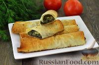 Фото к рецепту: Рулетики из лаваша с зеленью