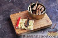 Фото приготовления рецепта: Шпроты в крабовых палочках - шаг №6