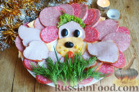 Фото к рецепту: Колбасная нарезка «Собачка»
