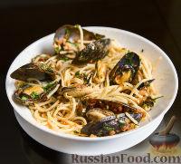 Фото к рецепту: Паста с мидиями в томатном соусе