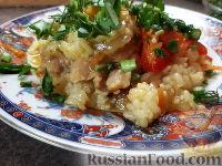 Фото к рецепту: Куриные бедрышки с карри, тушенные с рисом и овощами