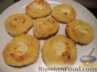 Фото к рецепту: Сырники, запеченные со сметаной