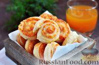 Фото к рецепту: Слоеные завитки с сыром