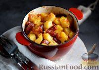 Фото к рецепту: Картофель с охотничьими колбасками (в горшочке)