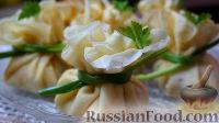 Фото к рецепту: Блинные мешочки с курицей, грибами и сыром