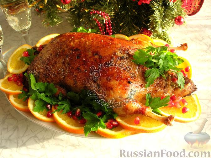 Фото к рецепту: Сочная утка, запеченная с апельсинами