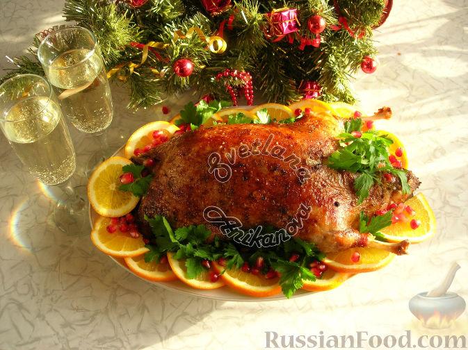 Фото приготовления рецепта: Сочная утка, запеченная с апельсинами - шаг №6