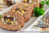 Фото к рецепту: Мясной рулет с грибами, яйцами, оливками