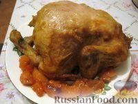 Фото к рецепту: Запеченная курица, фаршированная айвой