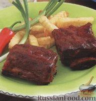 Фото к рецепту: Говяжьи ребрышки, приготовленные на гриле