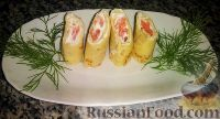 Фото к рецепту: Закуска из блинов с сыром и красной рыбой