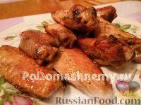 Фото к рецепту: Куриные крылышки в духовке