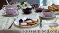 Фото к рецепту: Сырники с изюмом