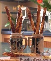 Фото к рецепту: Сырные палочки из слоёного теста