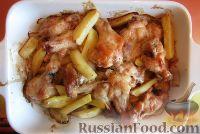 Фото к рецепту: Куриные крылья с картошкой (в духовке)
