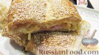 Фото к рецепту: Слоеный пирог с ветчиной и сыром