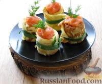 Фото к рецепту: Блинчики-улитки с творожным сыром и рыбной икрой
