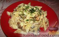 Фото к рецепту: Макароны с курицей, грибами и сыром