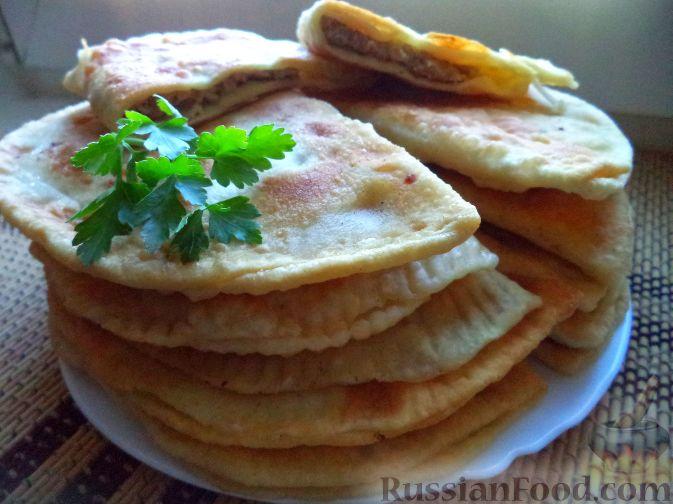 Фото приготовления рецепта: Картофель, тушенный с сосисками и фасолью - шаг №13
