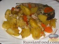Фото к рецепту: Толстолобик, запеченный с овощами
