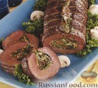 Фото к рецепту: Говяжье филе, запеченное с сыром, шпинатом и грибами