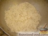 Фото приготовления рецепта: Рисовая каша молочная - шаг №4