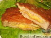 Фото к рецепту: Свиная отбивная с сыром