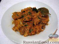 Фото к рецепту: Тушеная капуста с мясом