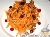 Фото к рецепту: Салат из моркови с изюмом
