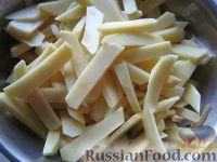 Фото приготовления рецепта: Картошка с мясом в горшочках - шаг №7