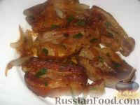 Фото к рецепту: Свиные ребра с луком