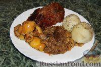 Фото к рецепту: Утка с яблоками и квашеной капустой