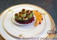Фото к рецепту: Авокадо, фаршированный крабовыми палочками