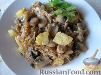 Фото к рецепту: Капуста кислая тушеная с грибами