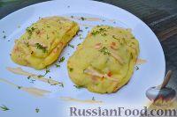 Фото к рецепту: Дорада, запеченная с грибами и сыром